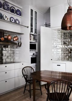 See options like this on our website or in our showroom! www.carolinawholesalefloors.com    Templeton - awesome silver backsplash tiles spice up white kitchen