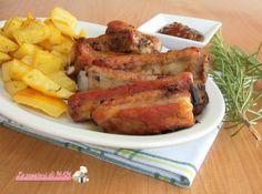 Costine in salsa bbq nel fornetto Versilia ricetta secondo piatto, costine di maiale glassate con la salsa barbeque e cotte nel fornetto Versilia.