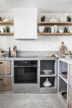 Beautiful kitchen design with details and coziness. Who wants to cook? Photography by Riitta Sourander.