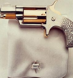 Bling Bling...the right way...@Lillah Dunmire @Melissa MillAr  When the day comes that someone wants to propose to me..make sure they set it up with a gun like this. :)