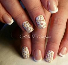 White and Transparent Floral Nail Art Design. If you think French Tips are too old to try, you can make it a little classy with this floral and studded design.