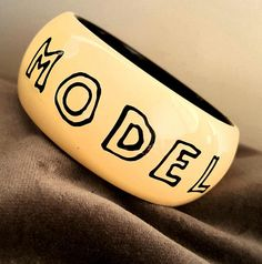 Vintage 80's RAFIA & BOSSA PARIS Chunky Resin Bangle - 'Top Model'  Design in Cream with Black Lettering,  Rare! Plastic Jewellery, Costume Jewelry, Sunglasses Case, Vintage Items, Resin, Bangles, Product Description, Lettering, Paris