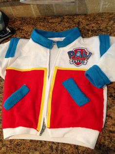 Paw Patrol Ryder jacket!  I used a white hoodie (cut off the hood) and sewed on the fleece details.  The yellow is binding tape.  I didn't put the red fleece on the back of the jacket bc it's hot here in CA.  I ordered the patch online. Mission complete.