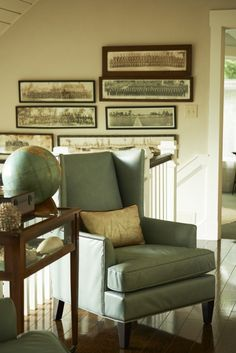 Mitchell Gold's home is a showplace for his many collections, including several military photographs that lead the way up the stairs. | coastalliving.com
