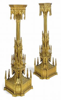 A PAIR OF LATE VICTORIAN GOTHIC GILT-BRONZE STANDS CIRCA 1880 The hexagonal tops above stems cast overall with architectural elements and figures including crockets and outset spires, formally candelabra 47 in. (119.5 cm.) high (2)