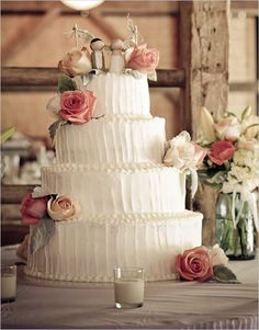 I love, love, love this cake! See how it maintains the home-made, real-icing look, but is also completely elegant and classy! The cake toppers are darling too.