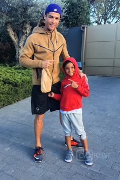 Cristiano Ronaldo wearing Nike Tech Hero Full Zip Hoodie, Nike Cr7 Madeira Edition Free Trainer 3.0 Sneakers