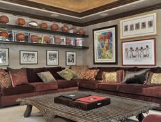 Display the sports valuables on long shelves in the man cave