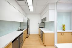Colliers International - SSDG Interiors Inc. New Kitchen Cabinets, Upper Cabinets, Staff Lounge, White Quartz Counter, Glass Tile Backsplash, Lunch Room, Modern Interior Design, Vancouver, Flooring