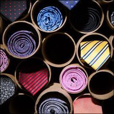 Rolling men's neckties gives them visual presence in side view. Displaying in stacked cardboard mailing tubes creates a vertical means of display and adds the drama of deep shadow and three-dimensi… Boutique Interior, Clothing Store Interior, Store Window Displays, Market Displays, Retail Displays, Merchandising Displays, Charity Shop Display Ideas, Shop Ideas, Tie Storage
