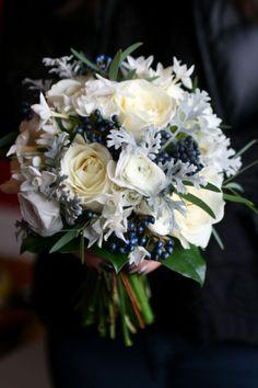 Bouquet in white and midnight blue with roses, ranunculus, viburnum berries, senecio, eucalyptus and salal.