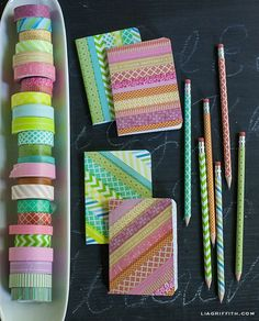 notebooks and pencils decorated with washi tape