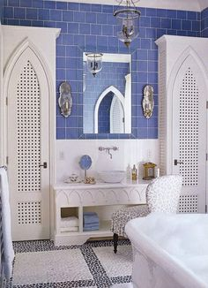 This will probably never match the style of an ounce of my own decorating but i love it just the same  Moroccan accents in the bath plus blue wall tiles.