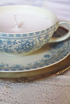 handmade candle in a vintage tea cup