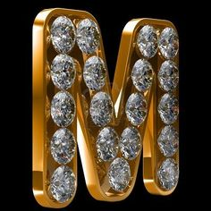"Golden letter ""M"" encrusted set with 19  diamonds."