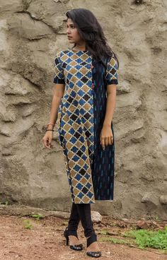 The asymmetry is created by joining the hand block printed panel with a cotton ikat panel  at the front. The joint is further enhanced by wooden tassels.  The fabric has been block printed by specialised artisans. Pair it with trousers for a contemporary look.  #fashion #fashionista #fashionbloggers #style #fashionstyle #trending #kurta #top #contemporary #trendy #love  #designer #designerwear #outfit #shop #online #indian #getnatty #gift #birthday #anniversary #party #casuals #officewear