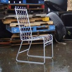 is an upcycled galvanized steel chain-link chair with stainless steel ...