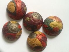 Polymer clay cabochons by Lisa Haney.