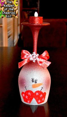 Snowman Wine Glass Candle Holder Girl Snowman Christmas Wine Glasses (Candle Holders) - made with dollar store wine glasses and glitter blast spray paint Wine Glass Crafts, Wine Craft, Wine Bottle Crafts, Wine Bottles, Bottle Art, Wine Glass Candle Holder, Wine Candles, Beeswax Candles, Christmas Snowman