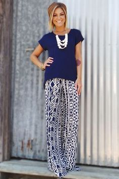 Fashion trends | Blue top, matching printed pants, statement necklace.