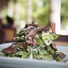 Steak on a romaine salad