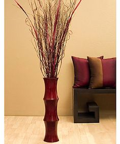 @Overstock - Give your home a contemporary feel with this stunning red floor vase. Handcrafted from mango wood, this vase holds a five-foot-tall arrangement of palm stalks, branches, and ting ting curls that will add color as well as a natural element to your room.http://www.overstock.com/Home-Garden/Scalloped-Floor-Vase-Burgundy-Palm-Stalks/2580773/product.html?CID=214117 $69.99