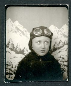 ** Vintage Photo Booth Picture **   Fun snowy mountain backdrop and a boy who's ready to fly with his pilot cap and goggles.