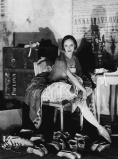 Anna Pavlova surrounded by her ballet shoes in her dressing room at the Theatre des Champs Elysees in Paris, 1927.
