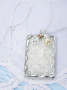 piece of wedding dress lace....the concept....keepsake that is practical
