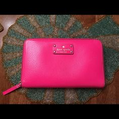 Kate Spade Travel Wallet Hot pink travel wallet. This is larger than a typical zip around. Vibrant and fun year round. kate spade Bags Wallets