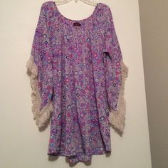 Top Size large dressy shirt/tunic with lots of colors! It has purple, blue, navy, white and pink and bell sleeves with fringe on the ends. Worn once but in mint condition. It's kind of long so it would look cute with leggings or skinny jeans! Tops
