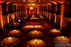 warm uplighting and pin spot lights on tables