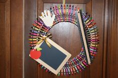 """This colorful HANDmade """"Handful of Crayons"""" wreath will add a nice touch to any classroom, school, teacher's home, or your home. This makes the perfect teacher wreath for any occasion, as well as for any homeschool teacher. If displayed in the classroom the teacher can leave his or her students a daily note on the chalkboard."""