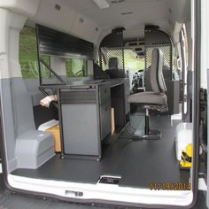 A completed upfit package with the Mobile Office desk and chair in the back of a 2015 Ford Transit. GoErgo.com
