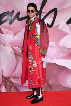 Jared Leto attended the British Fashion Council Awards where he presented Alessandro Michele with the prize for International Accessories Designer, in a Gucci Spring Summer 2017 red silk embroidered reversible kimono, double breasted shantung evening jacket, yellow crystal bowtie, wool trousers with white piping and GG buckle moccasins.