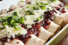 Thanksgiving leftovers: turkey and black bean cran-chiladas with pepperjack cheese...I make these every year and they are so flavorful and delicious!  Can't wait!  {Pink Parsley}