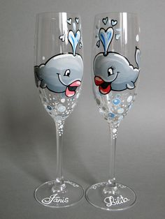 Hand painted Wedding Toasting Flutes Set of 2 Personalized Champagne glasses Wedding theme Whales. $49.00, via Etsy.