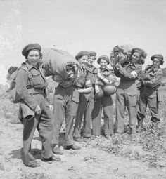 A cheery party of Sisters of Queen Alexandra's Imperial Military Nursing Service with their baggage at No 88 General Hospital at La Delivrande, Normandy.