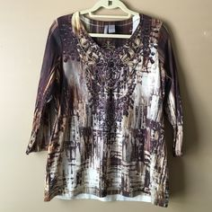 New Directions Top Colors of brown, tan, burgundy and etc. long sleeves, v neckline with studs and sequins around the front. Never worn and excellent condition. new directions Tops