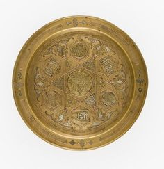 Tray Egypt, late century Metal Brass inlaid with silver and copper Diameter: 12 in. Islamic World, Islamic Art, Antique Oil Lamps, Ancient Egyptian Art, Fantasy Miniatures, Oriental, Metal Working, Persian