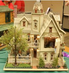 Beige dollhouse with landscaping