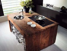 Amazing use of reclaimed wood. The texture, color and weight a nice outweight for the modern look around it.