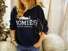 http://www.glamzelle.com/collections/tops/products/homies-south-central-sweater