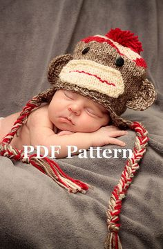 I NEED this knitting pattern!! a sock monkey baby hat :D
