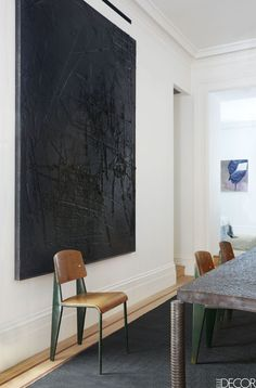 A painting by Rashid Johnson in the same room; the custom jute rug is from Lawrence of La Brea, and the walls throughout the apartment are painted in Farrow & Ball's All White.