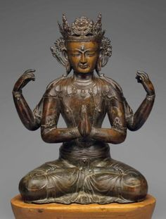 A LARGE SILVER- AND COPPER-INLAID BRONZE FIGURE OF SHADAKSHARI AVALOKITESHVARA TIBET, 15TH CENTURY 18 1/8 in. (46 cm.) high