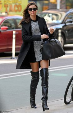 Model Miranda Kerr highlights her long legs in thigh high boots as she arrives for a day at work shooting the new Victoria's Secret campaign on Monday morning in New York