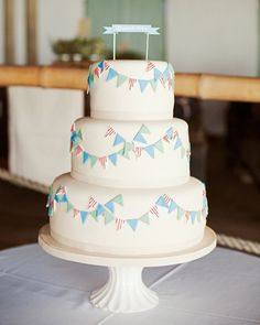 a cake with bunting (I saw one like this window shopping last weekend in Cambridge!)