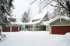 This northwoods home in Vilas County, WI is made to look like a 1920's cottage. The exterior colors are awesome against the snow aren't they? The owner of this newly built custom home did a great job of picking colors and creating the look that they wanted. The garage on the right is actually a remodel to match the new home.