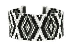 Boho Betty Mexico bracelet - Aztec Allure collection - Striking black and silver beads contrast perfectly, creating a bold, daring and elegant look in this ultramodern cuff.  Make a statement from day to night with the edgy and glamorous Aztec design. #LoveBohoBetty #BohoBetty #Fashion #Jewelry